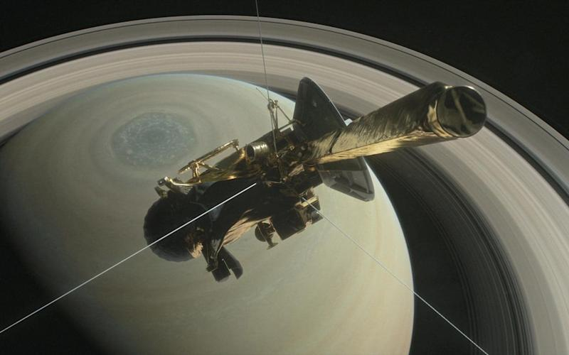 The Cassini spacecraft circling Saturn on 29 August 2017 - REUTERS