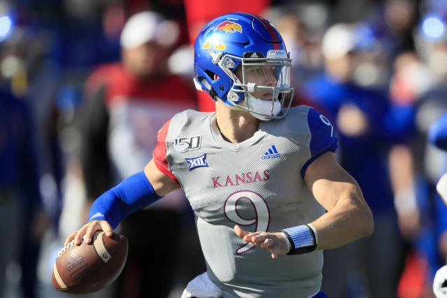 Kansas quarterback Carter Stanley (9) passes to a teammate during the first half of an NCAA college football game against Kansas State in Lawrence, Kan., Saturday, Nov. 2, 2019. (AP Photo/Orlin Wagner)