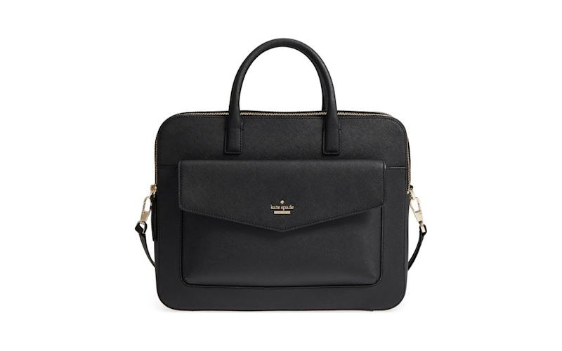 d66ef762506 This sleek designer bag features an interior laptop compartment, wall  pockets, and an exterior