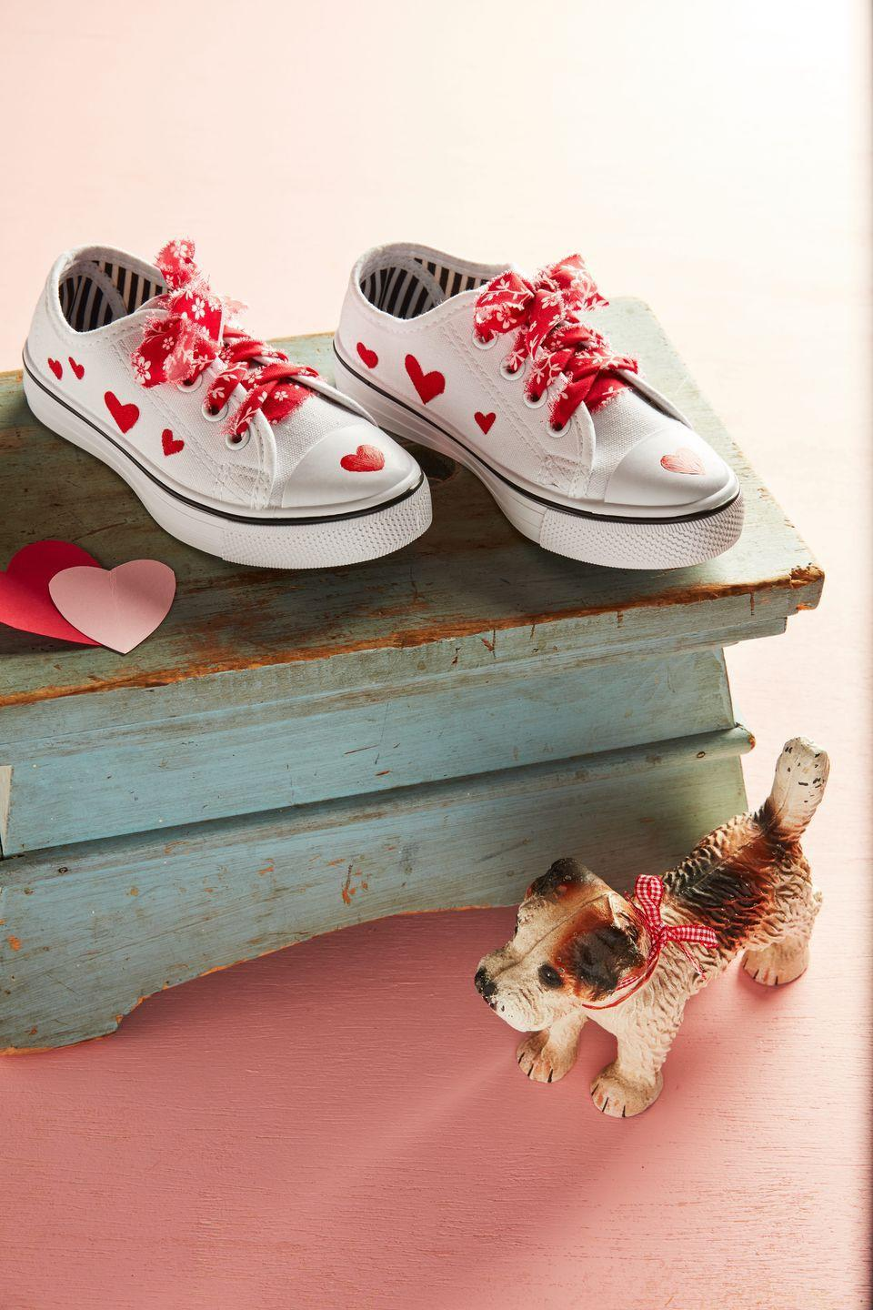 "<p>Kids will strut their stuff this Valentine's Day in DIY decorated sneakers with colorful fabric laces.</p><p><strong>To make:</strong> Use fabric paint to paint hearts on the top and sides of sneakers. Tear a long piece of fabric into thin strips and thread through eyelets. </p><p><a class=""link rapid-noclick-resp"" href=""https://www.amazon.com/Jacquard-Products-Textile-Fabric-2-25-Ounce/dp/B0006IK268/ref=sr_1_3?tag=syn-yahoo-20&ascsubtag=%5Bartid%7C10050.g.1584%5Bsrc%7Cyahoo-us"" rel=""nofollow noopener"" target=""_blank"" data-ylk=""slk:SHOP FABRIC PAINT"">SHOP FABRIC PAINT</a></p>"