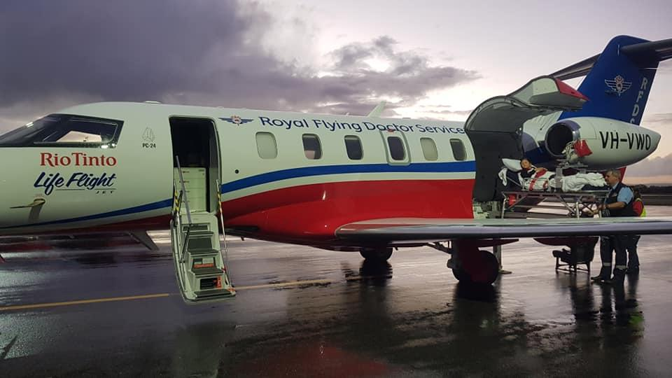 A photo of Liam Rogers being loaded into a RFDS aircraft to airlifted to the Perth Children's Hospital for surgery