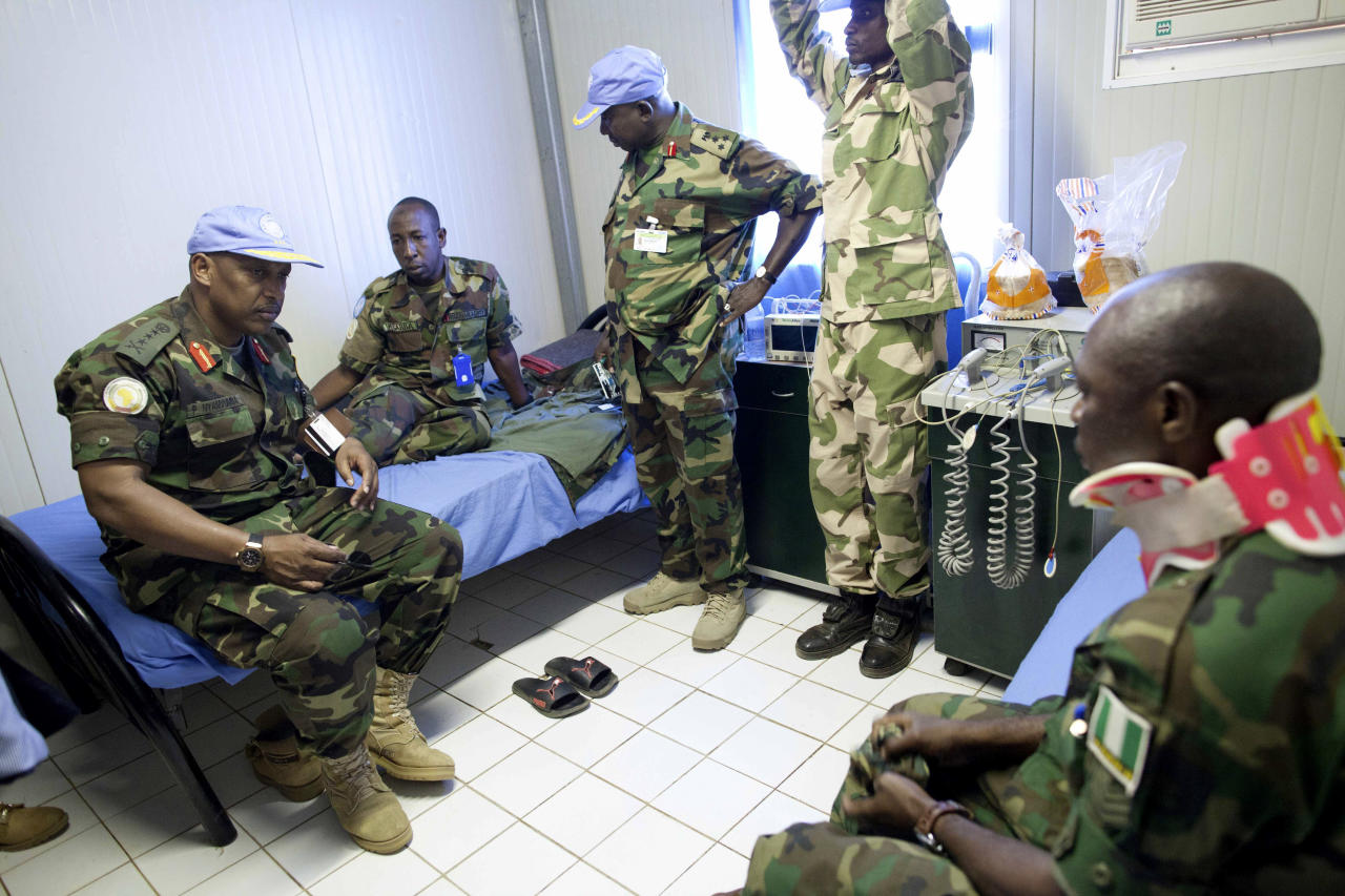 "In this photo released by the United Nations African Mission in Darfur (UNAMID), UNAMID Force Commander, Lieutenant General Patrick Nyamvumba from Rwanda, left, talks to an injured peacekeeper after an ambush Tuesday night that killed four peacekeepers, in El Geneina, Sudan, Wednesday, Oct. 3, 2012. United Nations spokesman Martin Nesirky says the secretary-general ""is appalled and deeply saddened"" at an attack that killed four Nigerian peacekeepers and wounded eight in Sudan's restive West Darfur region. (AP Photo/Albert González Farran, UNAMID)"