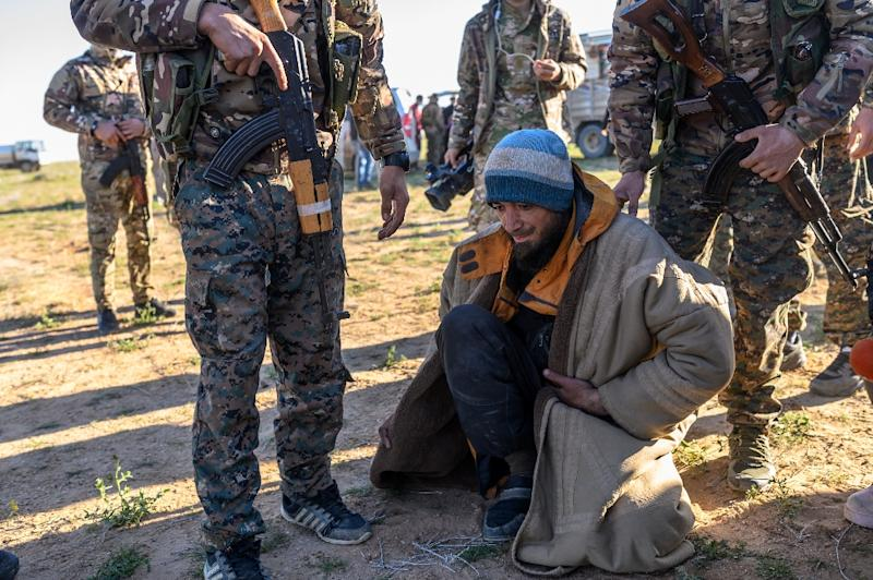 A suspected Islamic State group fighter is searched by members of the Kurdish-led Syrian Democratic Forces (AFP Photo/Bulent KILIC)