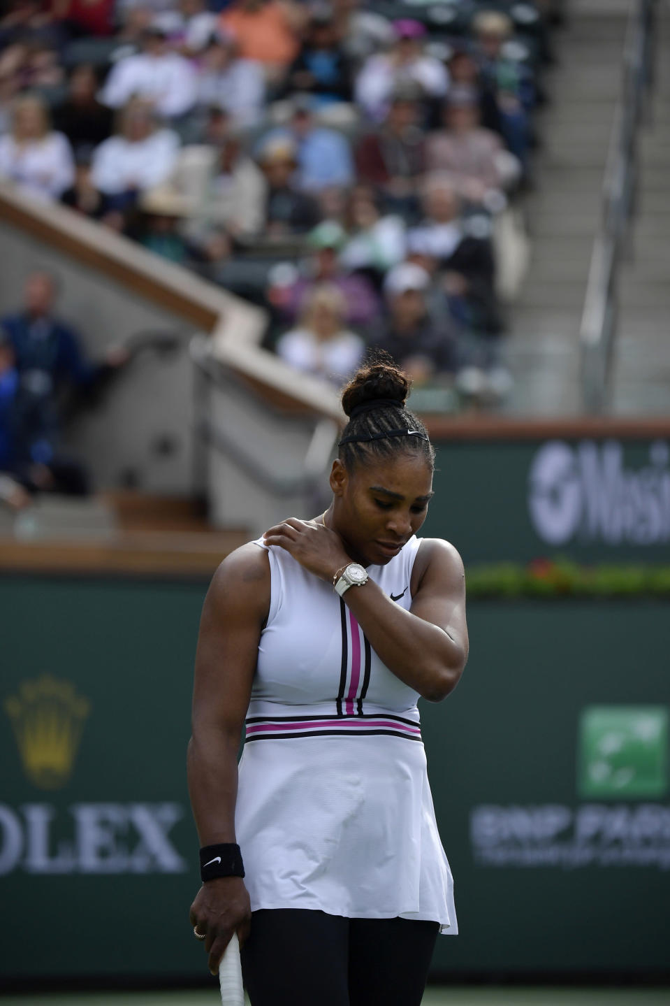 Serena Williams reacts during a match against Garbine Muguruza, of Spain, at the BNP Paribas Open tennis tournament Sunday, March 10, 2019, in Indian Wells, Calif. Williams retired from the match due to a medical issue. (AP Photo/Mark J. Terrill)
