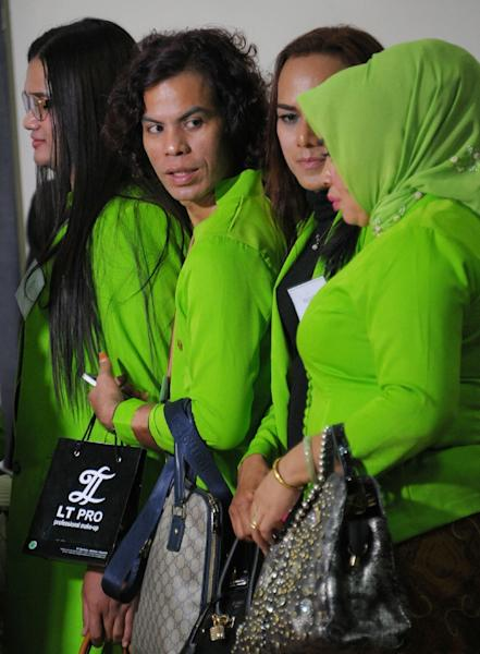 Transvestites who work as make-up artist lining up during beauty contest event in Banda Aceh (AFP Photo/Chaideer Mahyuddin)