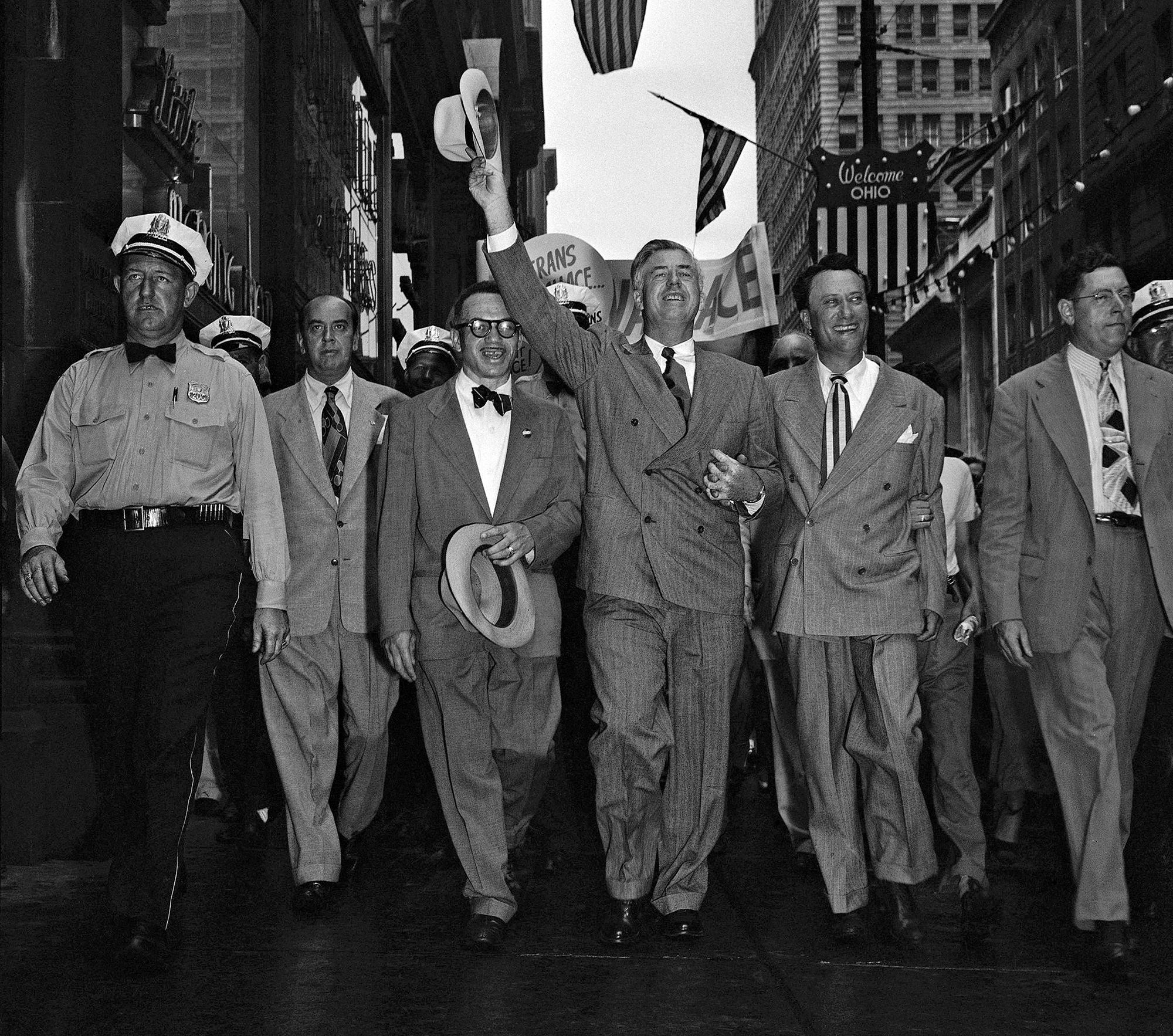 Henry A. Wallace, center, and his running mate, Sen. Glen Taylor, right, walk to their hotel in Philadelphia on July 23, 1948, after Wallace's arrival for the Progressive Party convention. (Photo: AP)