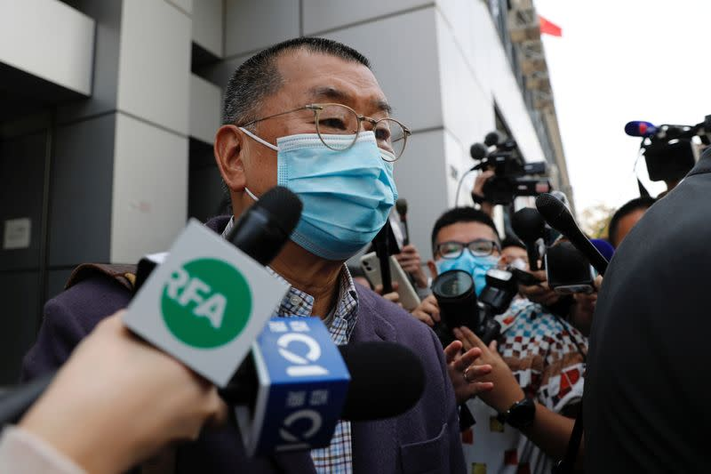 Media mogul and Apple Daily founder Jimmy Lai Chee-ying leaves from a police station after being arrested for illegal assembly during the anti-government protests in Hong Kong