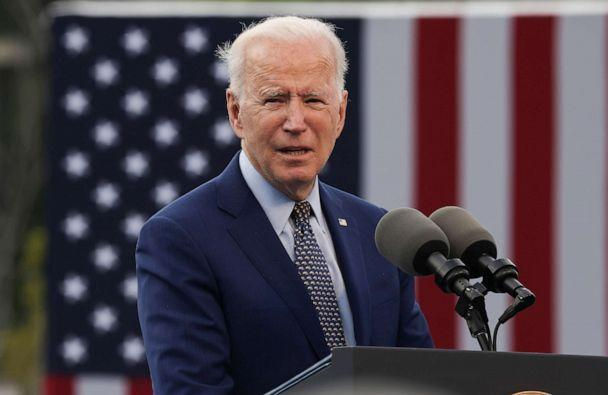 PHOTO: President Joe Biden speaks at a drive-in car rally to celebrate the president's 100th day in office at the Infinite Energy Center in Duluth, Georgia, April 29, 2021. (Evelyn Hockstein/Reuters)