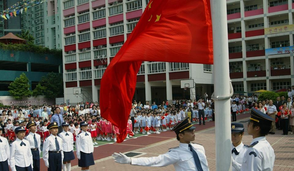Flag-raising ceremonies have taken on a renewed importance at schools throughout the city. Photo: Oliver Tsang