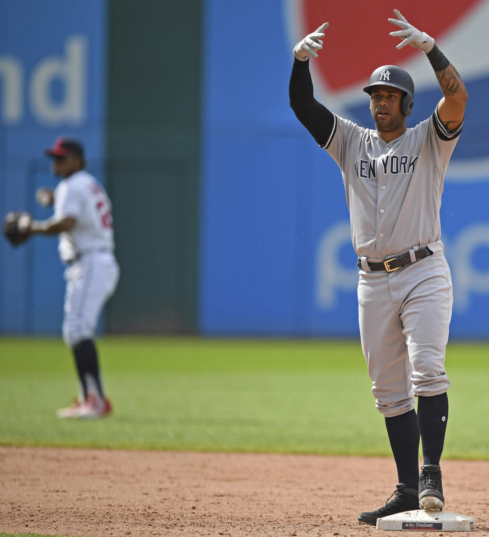 New York Yankees' Aaron Hicks celebrates after hitting a RBI double in the tenth inning of a baseball game against the Cleveland Indians, Sunday, June 9, 2019, in Cleveland. Cameron Maybin would score. The Yankees won 7-6. (AP Photo/David Dermer)