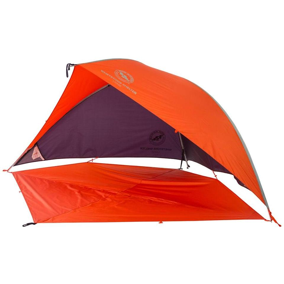 """The convertible design of Big Agnes' sun shelter is mighty handy, allowing you to easily reposition the shade behind, above, or in front of you. The floor can also latch to the uppermost point of the tent for privacy, and the exterior is waterproof, meaning that the shelter will protect you from sun and rain. At over 10 feet at the widest point, it even provides plenty of room for social distancing. <br> <br> <strong>BIG AGNES</strong> Whetstone Shelter with Floor, $, available at <a href=""""https://go.skimresources.com/?id=30283X879131&url=https%3A%2F%2Fwww.ems.com%2Fbig-agnes-whetstone-shelter-with-floor-large%2F2064353.html"""" rel=""""nofollow noopener"""" target=""""_blank"""" data-ylk=""""slk:EMS"""" class=""""link rapid-noclick-resp"""">EMS</a>"""