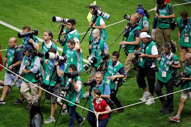 Soccer Football - World Cup - Group H - Poland vs Colombia - Kazan Arena, Kazan, Russia - June 24, 2018 Photographers on the pitch before the match REUTERS/Jorge Silva