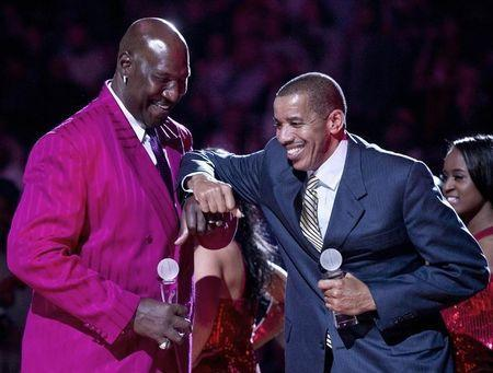 Former New Jersey Nets players Darryll Dawkins and Otis Birdsong (R) joke around during ceremonies celebrating 35 years in New Jersey during halftime in their NBA basketball game with the Philadelphia 76ers in Newark, New Jersey, April 23, 2012. REUTERS/Ray Stubblebine