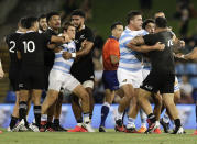 Players scuffle during the Tri-Nations rugby test between Argentina and the All Blacks in Newcastle, Australia, Saturday, Nov. 28, 2020. (AP Photo/Rick Rycroft)