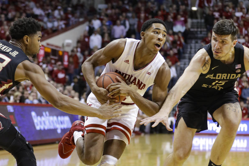 Indiana guard Armaan Franklin (2) drives between Florida State guard M.J. Walker (23) and center Dominik Olejniczak (15) during the first half of an NCAA college basketball game Tuesday, Dec. 3, 2019, in Bloomington, Ind. (AP Photo/Darron Cummings)