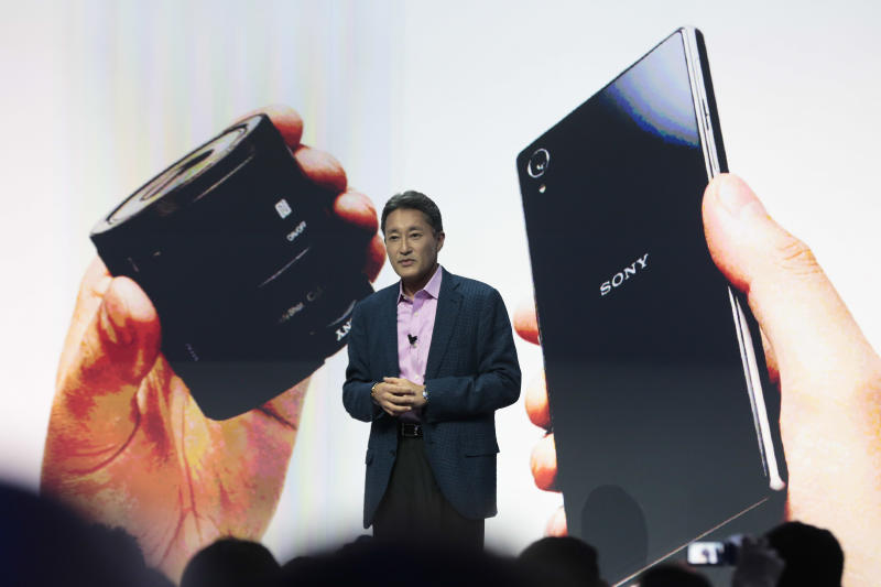 Kazuo Hirai, President and CEO of Sony presents the new Sony Xperia Z1 smartphone and an attachable lens style camera for smartphones on an event ahead of the IFA, one of the world's largest trade fairs for consumer electronics and electrical home appliances in Berlin, Wednesday, Sept. 4, 2013. IFA will take place on the Berlin Exhibition Grounds from Sept. 6 to Sept. 11, 2013. (AP Photo/Markus Schreiber)