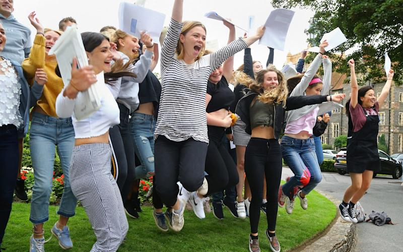 Students celebrate their A-level results at Brighton College in East Sussex - PA