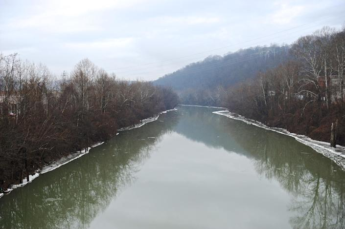 A stretch of the Elk River in Charleston, W.Va., is shown Friday, Jan. 10, 2014. The White House has issued a federal disaster declaration in West Virginia, where a chemical spill in the Elk River that may have contaminated tap water has led officials to tell at least 300,000 people not to bathe, brush their teeth or wash their clothes. The West Virginia National Guard planned to distribute bottled drinking water to emergency services agencies in the nine affected counties. About 100,000 water customers, or 300,000 people total, were affected, state officials said. (AP Photo/Tyler Evert)