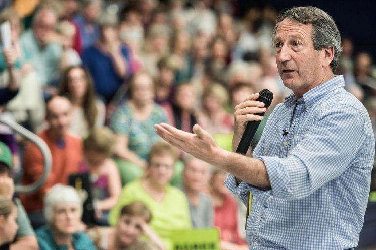 Rep. Mark Sanford (R-SC) addresses the crowd during a town hall meeting March 18, 2017 in Hilton Head, South Carolina. Constituents have been showing up in large numbers across the nation to congressional town hall meetings to voice their concerns.
