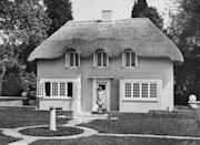 """<p>Y Bwthyn Bach or """"The Little Cottage"""" was gifted to then Princess Elizabeth by the Welsh people in 1932. The miniature thatched cottage has remained on the same grounds as the Royal Lodge since then, serving as the official royal playhouse for generations. </p>"""