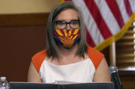 Arizona Secretary of State Katie Hobbs reads a statement prior to certifying the election results for federal, statewide, and legislative offices and statewide ballot measures at the official canvass at the Arizona Capitol Monday, Nov. 30, 2020, in Phoenix. (AP Photo/Ross D. Franklin, Pool)