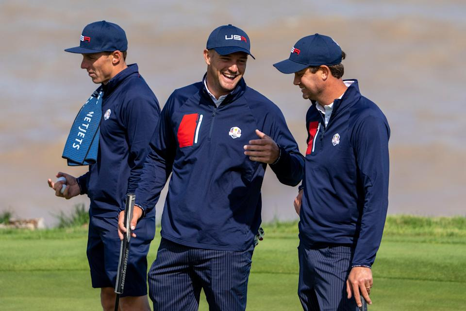 Team USA player Bryson DeChambeau (center) talks to player Harris English (right) on the 17th hole during a practice round for the 43rd Ryder Cup at Whistling Straits.