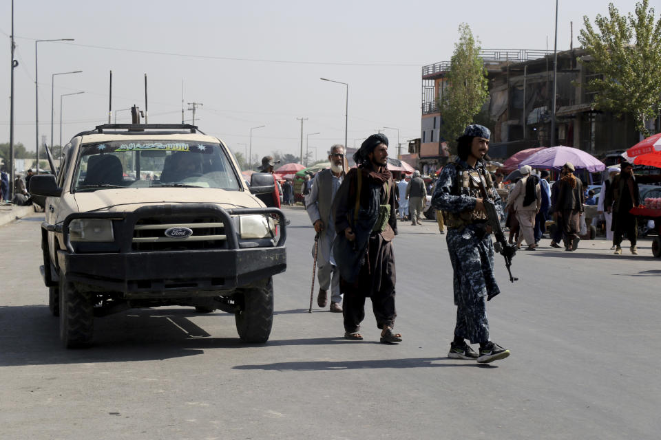 Taliban fighters walk in the city of Kabul, Afghanistan, Saturday, Sept. 4, 2021. (AP Photo/Wali Sabawoon)