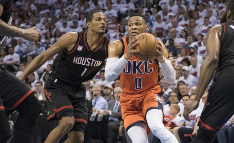 Russell Westbrook of the Oklahoma City Thunder looks to pass the ball in Game Four of their 2017 NBA Playoffs Western Conference quarter-finals against the Houston Rockets, in Oklahoma City, on April 23
