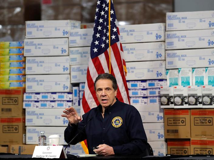 New York Governor Andrew Cuomo speaks in front of stacks of medical protective supplies during a news conference at the Jacob K. Javits Convention Center, which will be partially converted into a temporary hospital during the outbreak of the coronavirus disease (COVID-19) in New York City, New York, U.S., March 24, 2020.