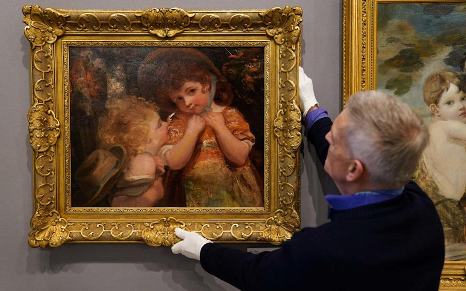 Russell Strachan adjusts the Sir Joshua Reynolds painting found 'beaten up' at an obscure auction - Jacob King/PA Wire