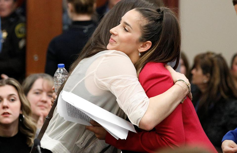 Victim and former gymnast Aly Raisman (R) embraces former USA teammate Jordyn Wieber (L) at the sentencing hearing for Larry Nassar. (REUTERS)