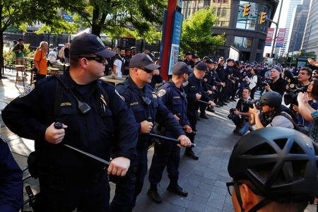 California Highway Patrol officers confront protesters during demonstrations near the Republican National Convention in Cleveland, Ohio, U.S., July 19, 2016.  REUTERS/Lucas Jackson