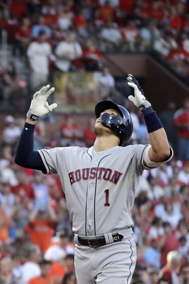 Houston Astros' Carlos Correa looks skyward as he arrives home after hitting a grand slam during the third inning of a baseball game against the St. Louis Cardinals Saturday, July 27, 2019, in St. Louis. (AP Photo/Jeff Roberson)