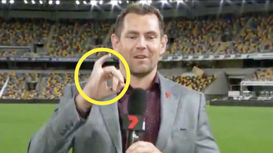 AFL legend Luke Hodge shows his right pinky finger during an interview.