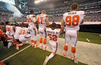 Sep 24, 2017; Indianapolis, IN, USA; The Cleveland Browns team stand and kneel during the National Anthem before the start of their game against the Indianapolis Colts at Lucas Oil Stadium. Mandatory Credit: Thomas J. Russo-USA TODAY Sports