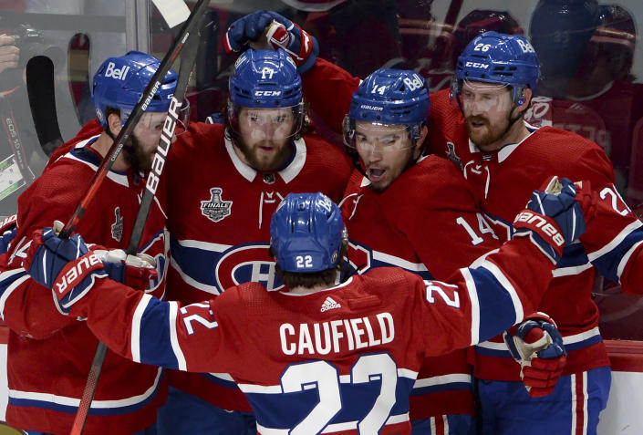 Montreal Canadiens' Josh Anderson (17) celebrates his goal against the Tampa Bay Lightning with teammates Joel Edmundson (44), Cole Caufield (22), Nick Suzuki (14) and Jeff Petry (26) during the first period of Game 4 of the NHL hockey Stanley Cup final in Montreal, Monday, July 5, 2021. (Ryan Remiorz/The Canadian Press via AP)
