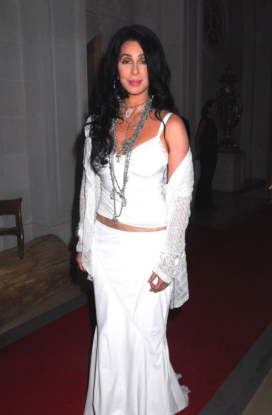 <p>In a white camisole, maxi skirt, and cardigan at a party during Paris Couture Week.</p>