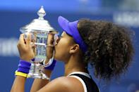 Naomi Osaka of Japan kisses the US Open trophy aftrer winning in 2020