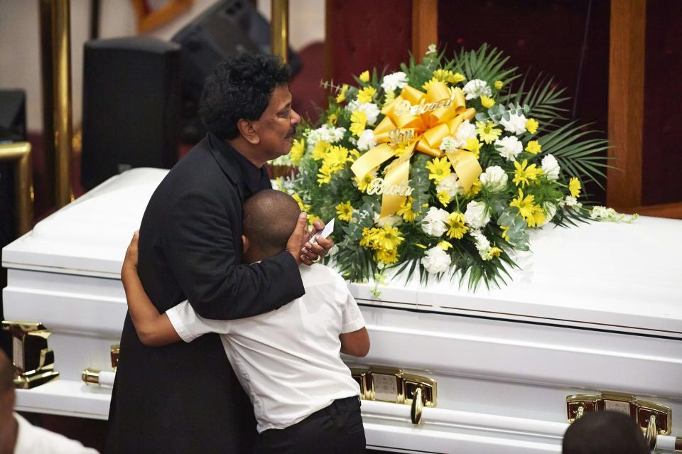 Unidentified mourners gather during a funeral service for Eric Garner at Bethel Baptist Church in Brooklyn, New York July 23, 2014. Family members gathered on Wednesday evening for the funeral of Eric Garner, who died shortly after police put him in a banned chokehold as they arrested him in New York City where the death has sparked outrage and a promise to reform police training. REUTERS/James Keivom/Pool (UNITED STATES - Tags: CRIME LAW OBITUARY)