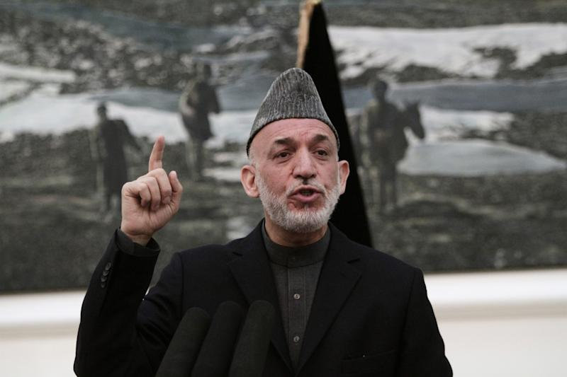 Afghan President Hamid Karzai speaks during a news conference in Kabul, Afghanistan, Saturday, May 4, 2013. Karzai says the director of the CIA assured him that regular funding his government receives from the agency will not be cut off. He says Afghanistan has been receiving such funding for more than 10 years and expressed hope at a Saturday news conference that it will not stop.(AP Photo/Rahmat Gul)