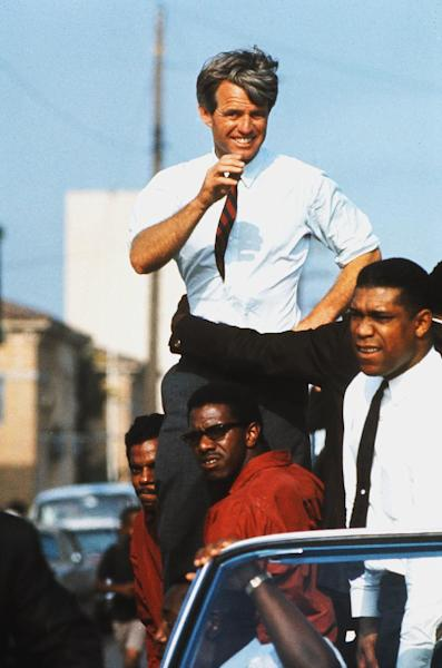 This June 1968 photo taken by Bill Eppridge and released courtesy of Monroe Gallery shows presidential hopeful Robert F. Kennedy campaigning in the Watts section of Los Angeles. Photojournalist Bill Eppridge, whose legendary career included capturing images of a mortally wounded Robert Kennedy, the Beatles and the civil rights movement, died, Thursday, Oct. 3, 2013 in Danbury, Conn., after a brief illness. He was 75. (AP Photo/Monroe Gallery, Bill Eppridge)