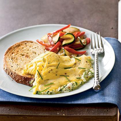 """<p>A tender omelet gains a salty boost from <a href=""""https://www.myrecipes.com/ingredients/ways-to-use-goat-cheese"""" rel=""""nofollow noopener"""" target=""""_blank"""" data-ylk=""""slk:goat cheese"""" class=""""link rapid-noclick-resp"""">goat cheese</a> without adding too much sodium. Serve with seedy whole-grain toast and fresh fruit for a hearty <a href=""""https://www.myrecipes.com/breakfast-and-brunch-recipes/"""" rel=""""nofollow noopener"""" target=""""_blank"""" data-ylk=""""slk:brunch"""" class=""""link rapid-noclick-resp"""">brunch</a>.</p>"""