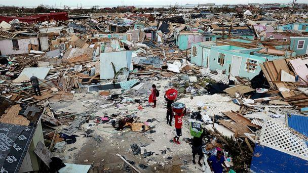 PHOTO: People search for salvageable items as they make their way through an area destroyed by Hurricane Dorian at Marsh Harbour in Great Abaco Island, Bahamas on Thursday, Sept. 5, 2019. (Al Diaz/Miami Herald via AP)