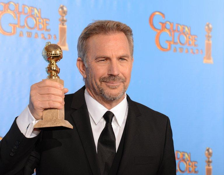 Costner poses in the press room with his award at the Golden Globe awards ceremony in Beverly Hills on January 13, 2013