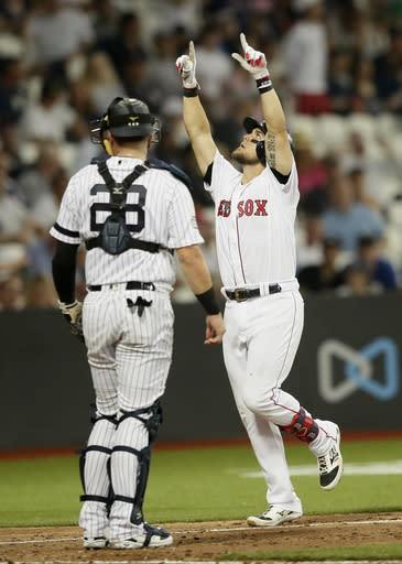 Boston Red Sox's Michael Chavis celebrates his three-run home run against the New York Yankees during the seventh inning of a baseball game, Saturday, June 29, 2019, in London. Major League Baseball made its European debut game Saturday at London Stadium. (AP Photo/Tim Ireland)