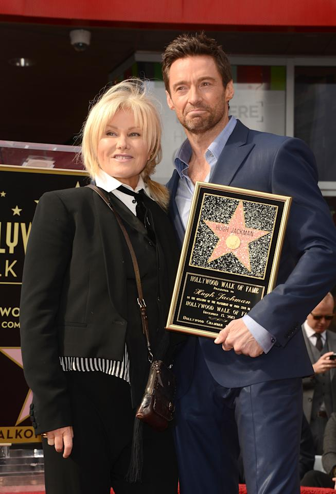 HOLLYWOOD, CA - DECEMBER 13:  Actor Hugh Jackman and his wife Deborra-Lee Furness pose as Hugh Jackman is honored with a star on The Hollywood Walk Of Fame on December 13, 2012 in Hollywood, California.  (Photo by Jason Merritt/Getty Images)