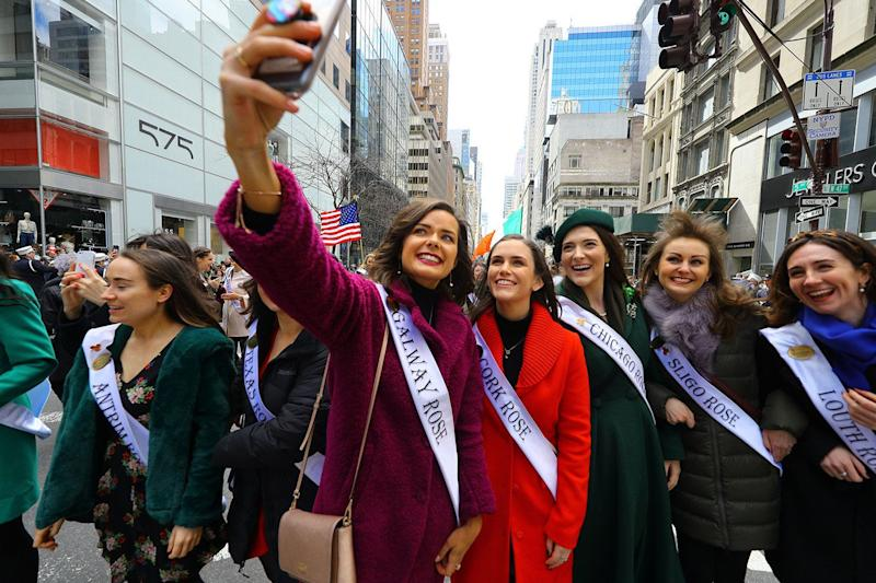 A woman takes a selfie with friends during a break while marching in the St. Patrick's Day Parade in New York City, March 16, 2019. (Photo: Gordon Donovan/Yahoo News)