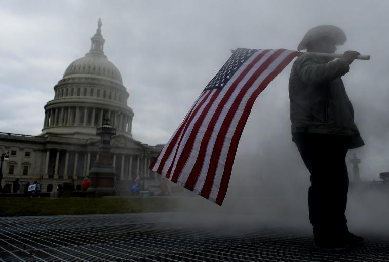 Supporters of US President Donald Trump hold a rally outside the US Capitol