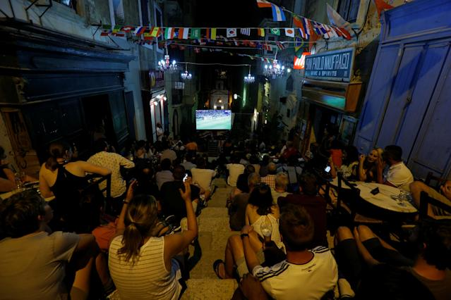 Soccer Football - World Cup - Group F - Germany vs Sweden - Valletta, Malta - June 23, 2018 Soccer fans watch the match on television outside a wine bar in Valletta. REUTERS/Darrin Zammit Lupi