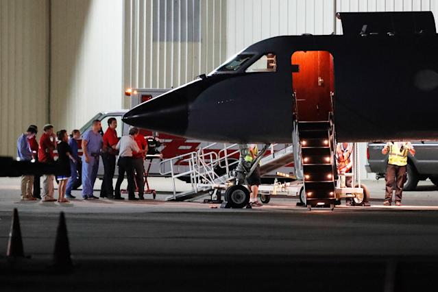 <p>Medical personnel and visitors gather at the nose of a transport plane carrying Otto Warmbier, a 22-year-old University of Virginia undergraduate student who was imprisoned in North Korea in March 2016, before he is transferred to an ambulance at Lunken regional airport, Tuesday, June 13, 2017, in Cincinnati, Ohio. (Photo: John Minchillo/AP) </p>